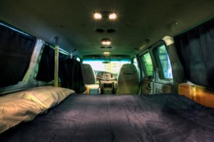 Northwest Van Campers: a bed inside a van